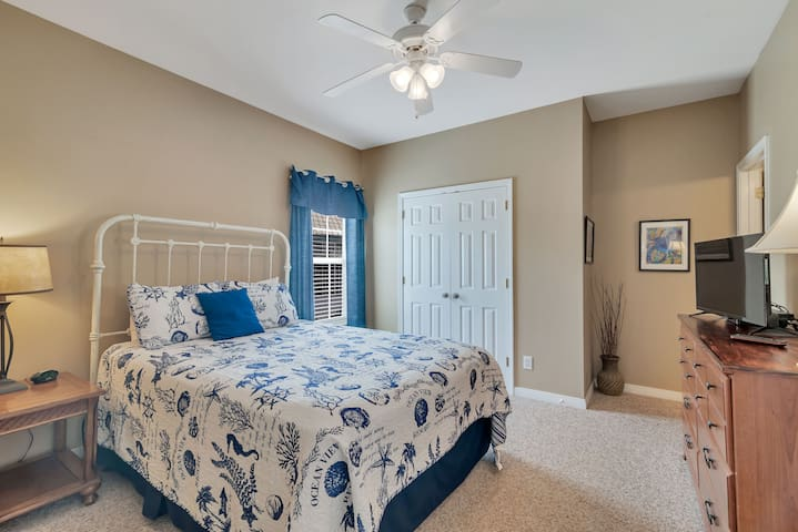 Master bedroom suite with attached bathroom