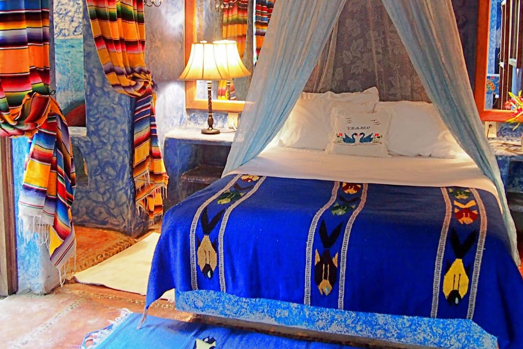 The Blue Angel Suite - ground floor with a queen bed inside and a smaller bed out under the covered terrace