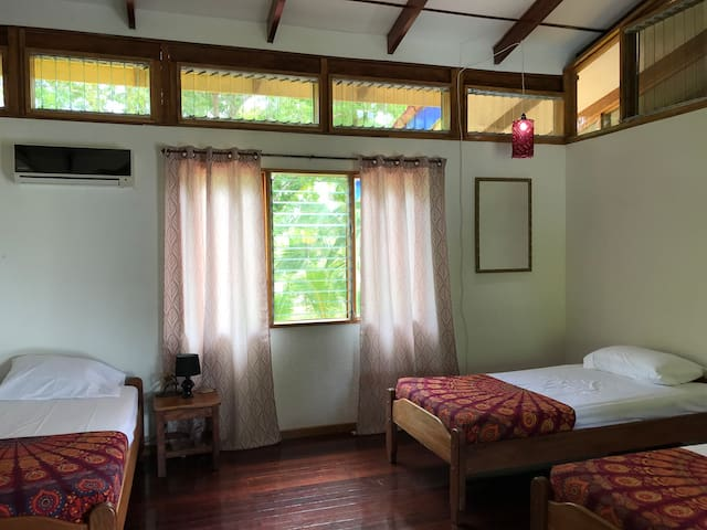 The Red Room  This room sleeps 3 with twin size beds. Featuring refrigerator, coffee maker, large desk space, and decor found right here in the Southern Zone of Costa Rica.
