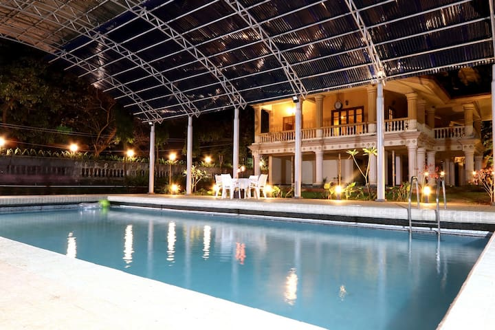 Mansion with pool at night  Parsi Mansion - 8 Beds + Big Pool+ Pool table - Villas for Rent in ...