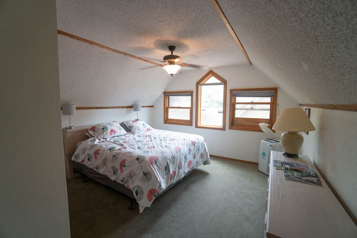 The sunrise room has 2 twin beds which are pushed together to be a king. There is an AC unit in there as well.