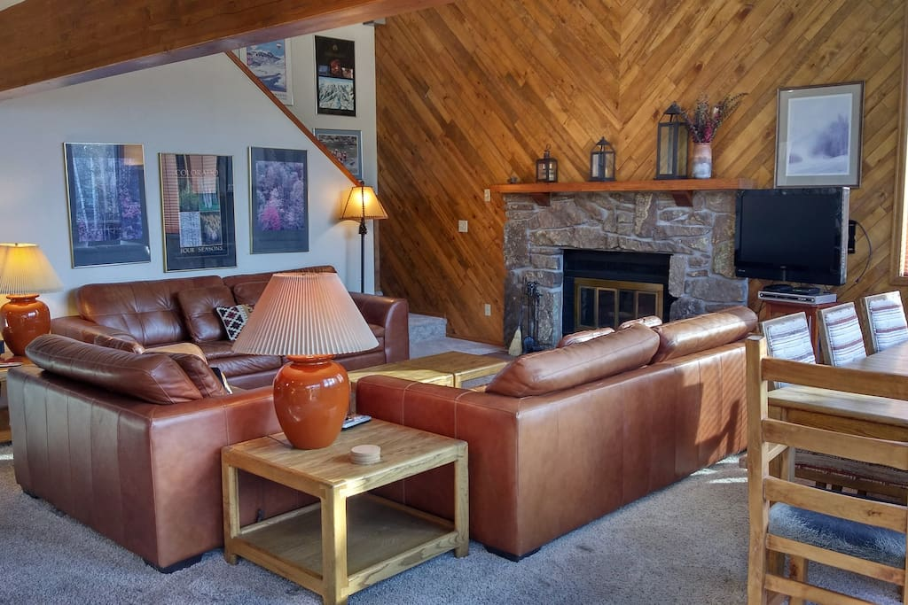 Living room with wood fireplace and dining table