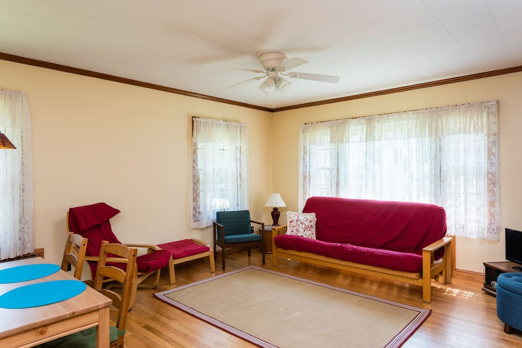 Sunny, open living area with comfortable double futon.