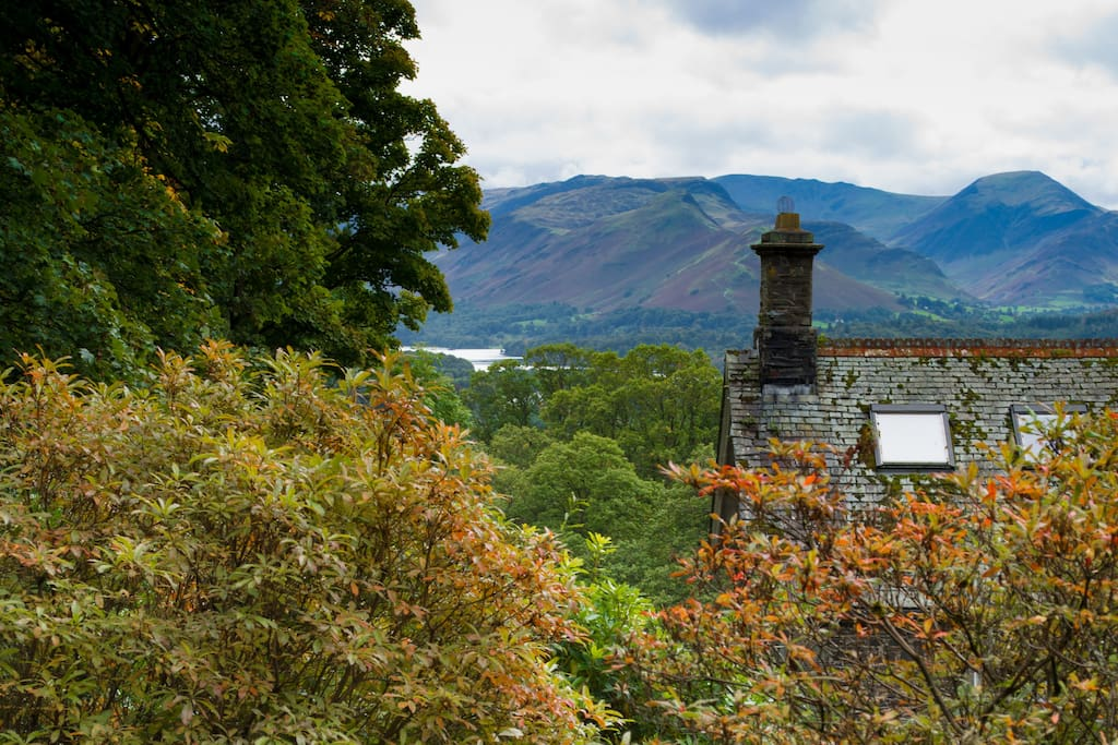 A view of Derwentwater and the surrounding mountains from a spot in the garden