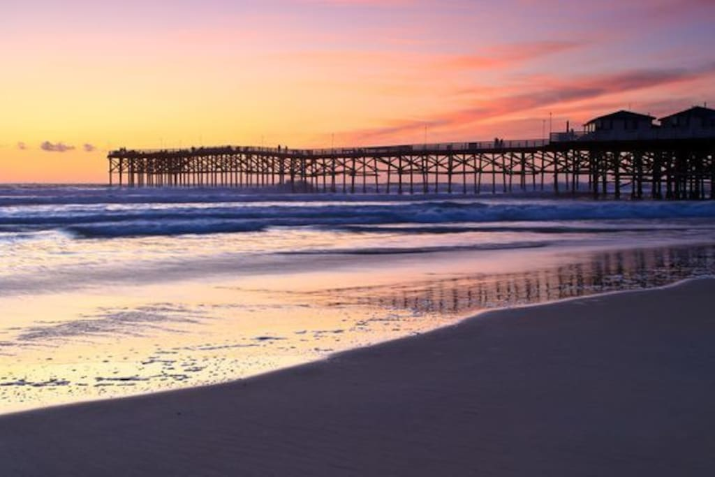 Pacific Beach Pier Sunset- we are 1 block to the beach, boardwalk and tons of local restaurants, cafes and coffee shops!