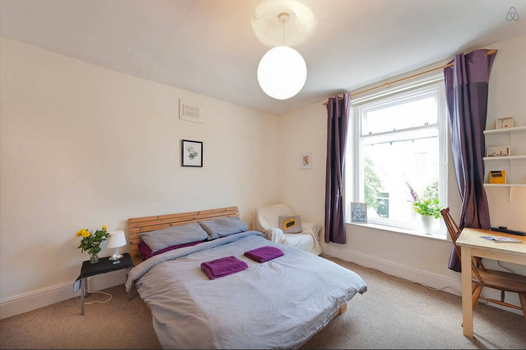 Comfortable and spacious master bedroom with double bed, desk and walk in closet.