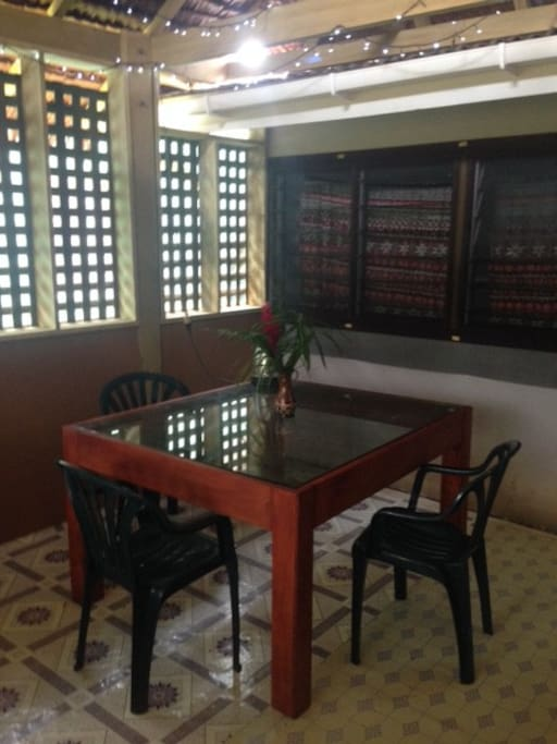Dining area with traditional Natangura thatch roof