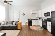 Open concept floor plan with extra pull out bed and gate leg table breakfast nook.