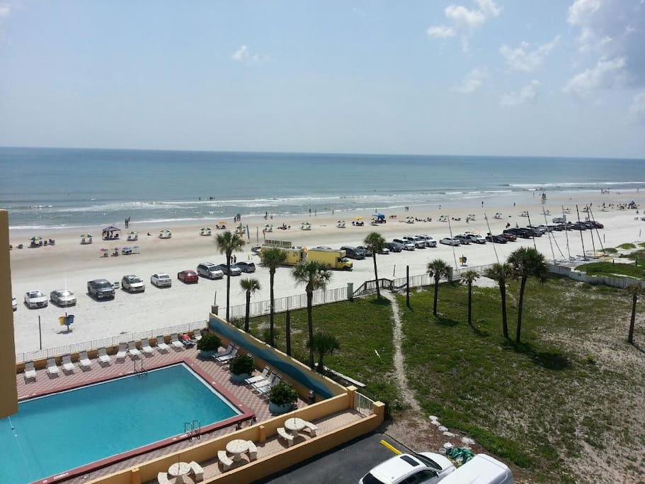 view from balcony to the pool and the beach.