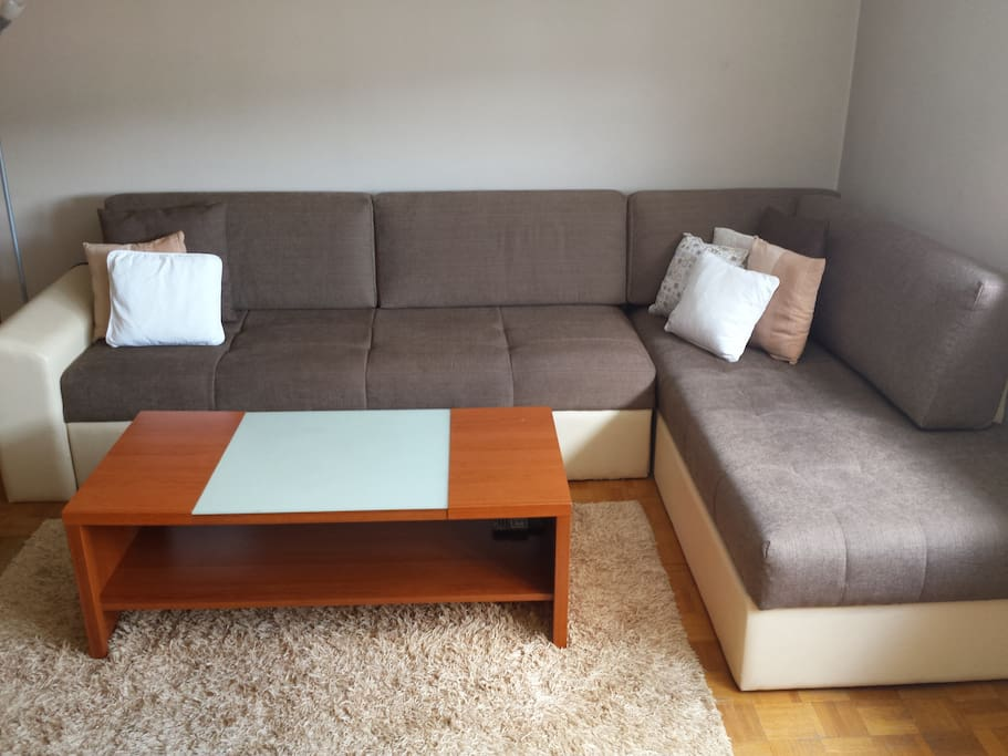 New sofa in living room, comfy for sleeping as well.