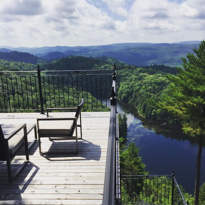 Contemporary outdoor furniture on the highest deck in the all of the Laurentians.