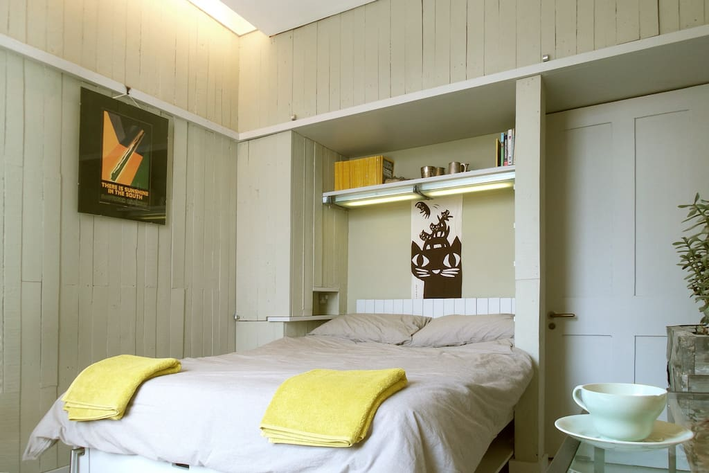 Your room. Hanging and storage space is concealed within the timber-boarded walls.