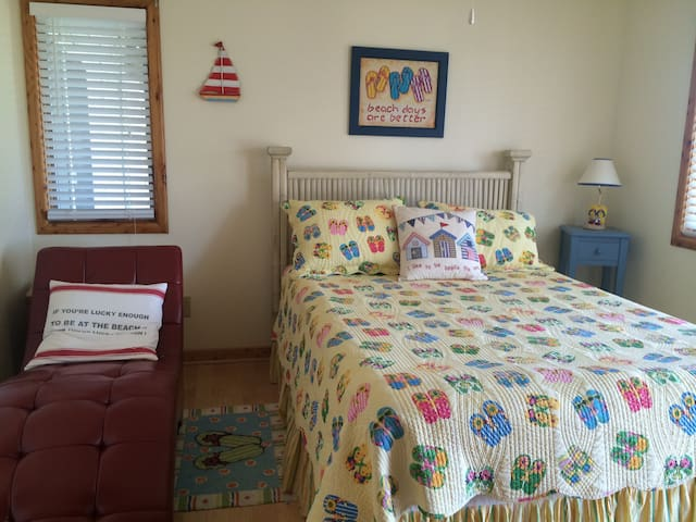 The Flip Flop Room - all of our bedrooms are light, bright and have deck access.
