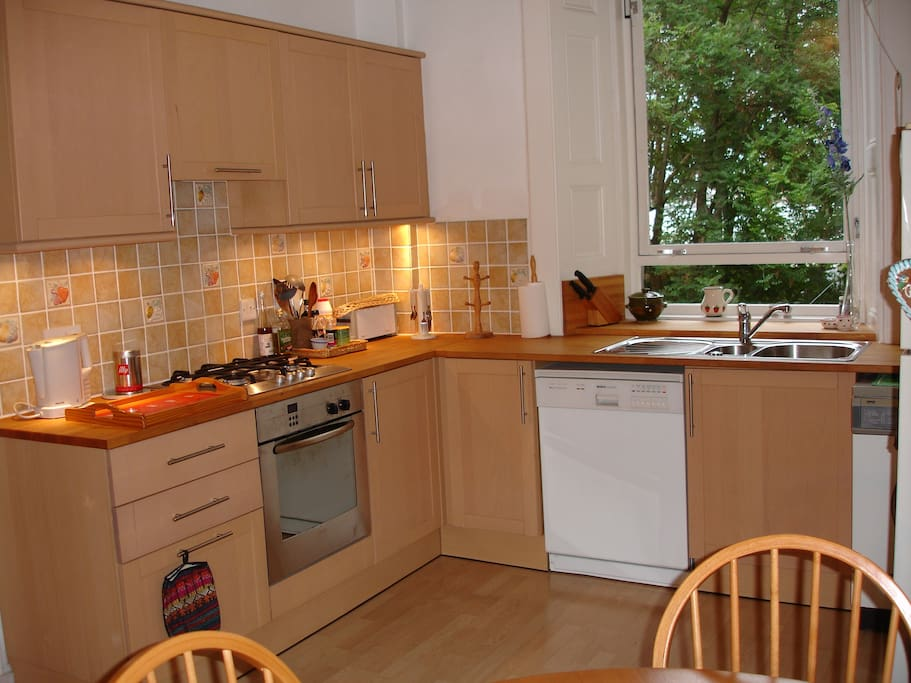 Spacious kitchen/dining room, with table & 4 chairs, fridge, dish-washer and washing machine