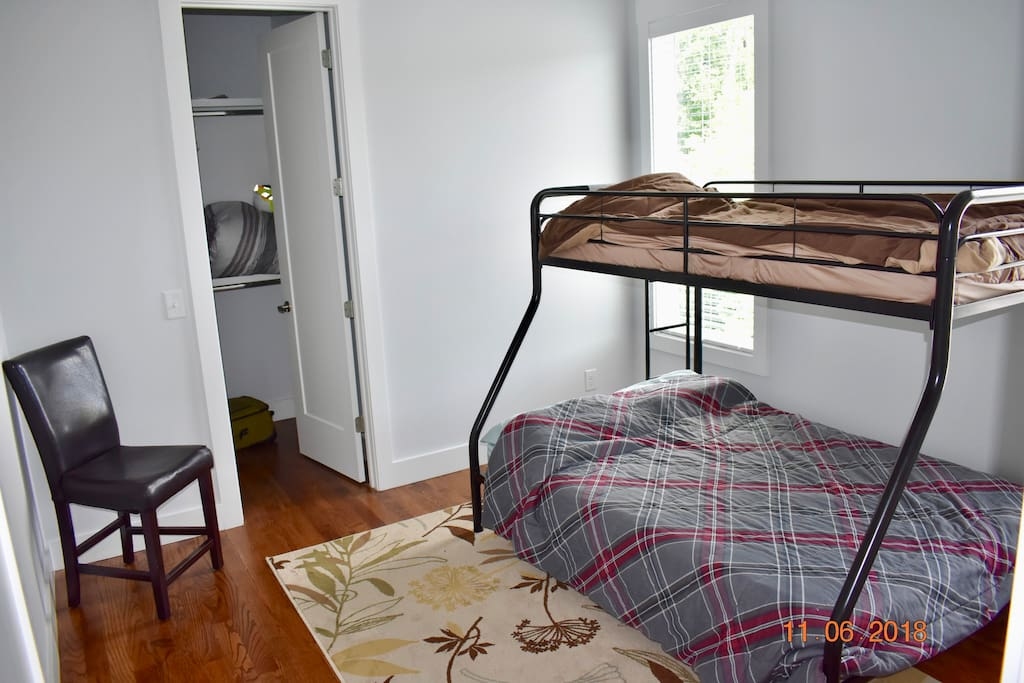Private room with a twin over full bunk bed (and space for an inflatable mattress), plus a walk in closet