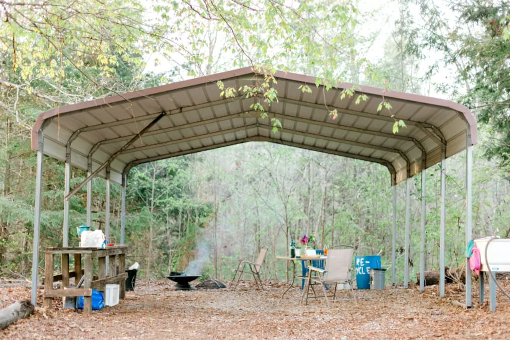 Covered dining, cooking and campfire area.