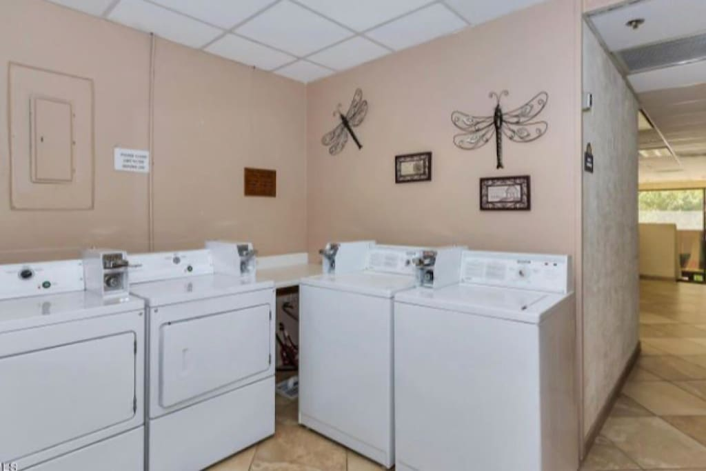 Community coin-operated laundry room available 24 hours per day