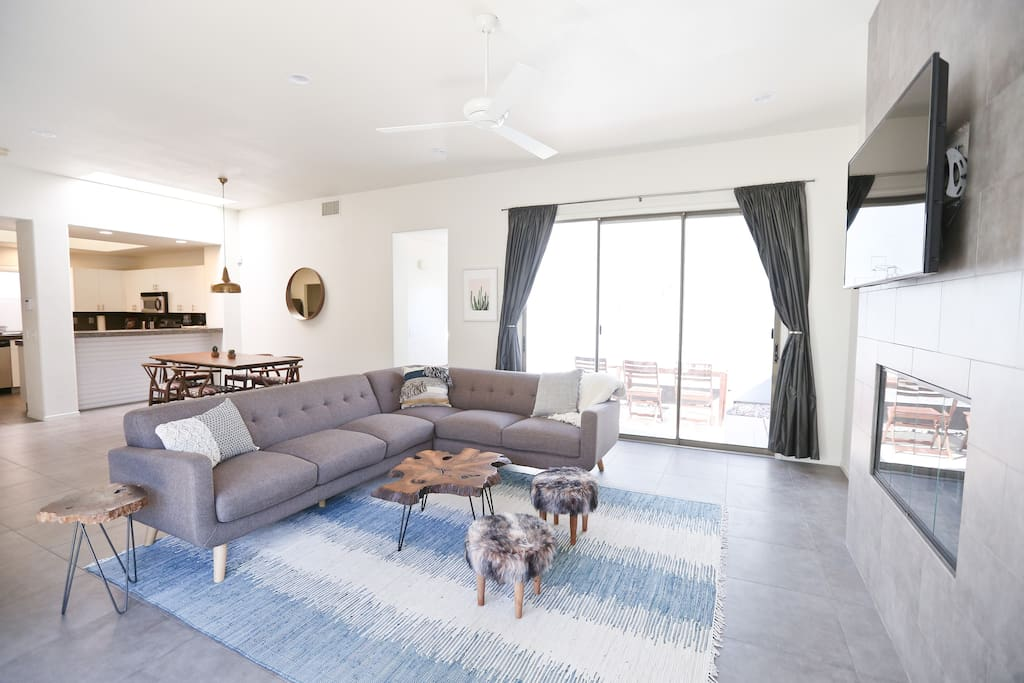 """Large and open living room with brand new 50"""" 4k Smart TV, with DIRECTV and Netflix!"""