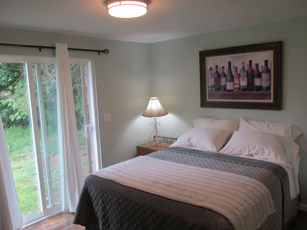 The bedroom has a Queen size bed, luxurious pillows and bedding, a mirrored closet and its own private attached bath room.