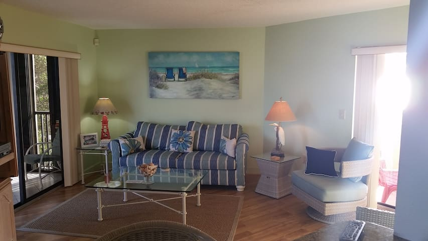 Living room has two decks. One overlooking Sarasota Bay (enclosed with glass and screens) with sunrise views and one deck overlooking Coquina Beach/Gulf of Mexico for sunset views.  Queen sleeper sofa in living room.
