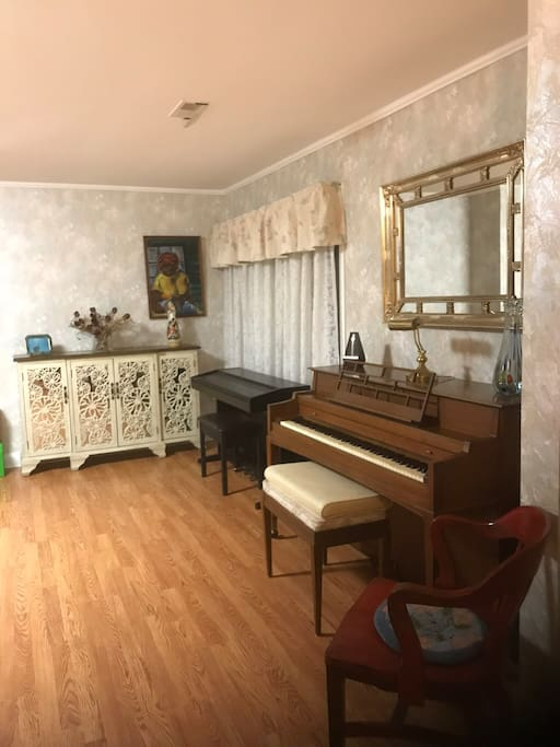 Section of living room with piano