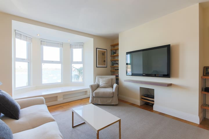 Living room showing internet TV, DVD and window seat