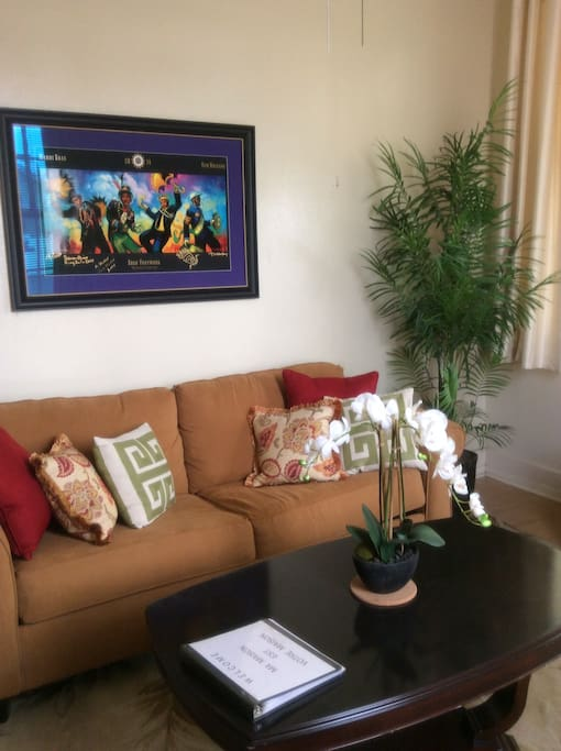Living room with NOLA Mardi Gras art.