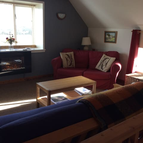 living room with extensive views over the bay and towards Cumbria