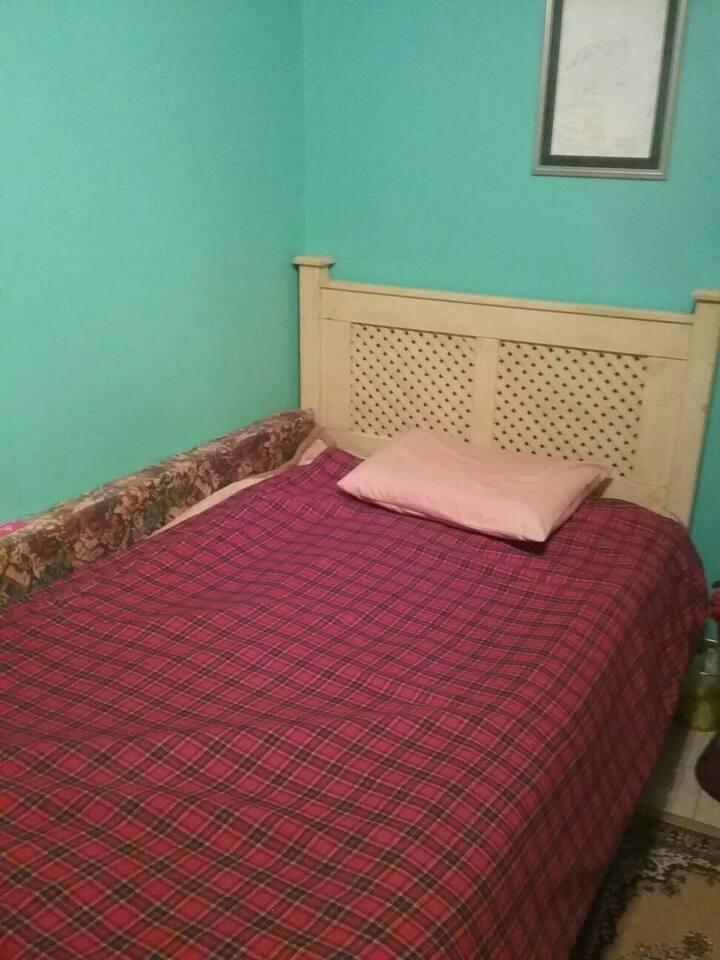 Single bed in private bedroom