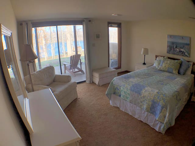 Lower level bedroom with lake views and access to patio