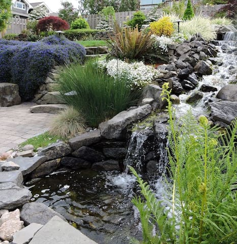 Waterfall is definitely the focal point of the rear yard and a guest favorite!