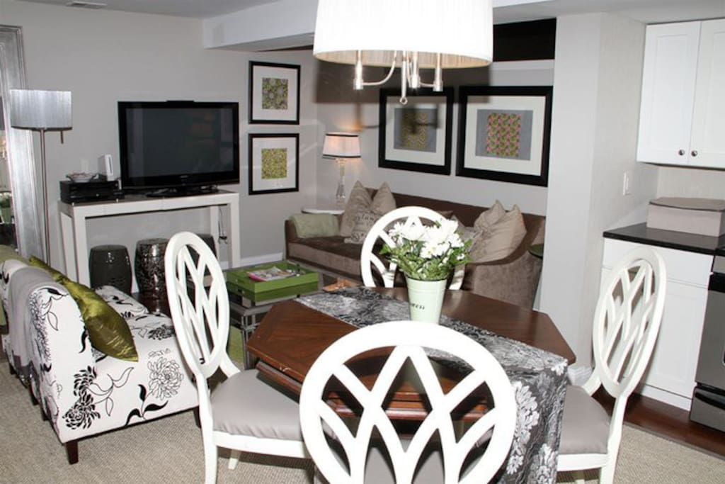 This is our dining area/kitchen/living room. You could sleep another person on this comfy couch and fit an air mattress.