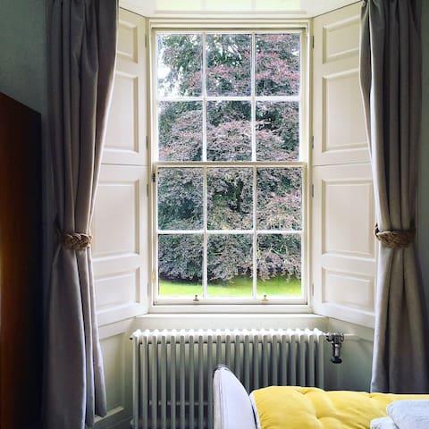 Bedroom one: super-kingsize garden room with rainfall shower