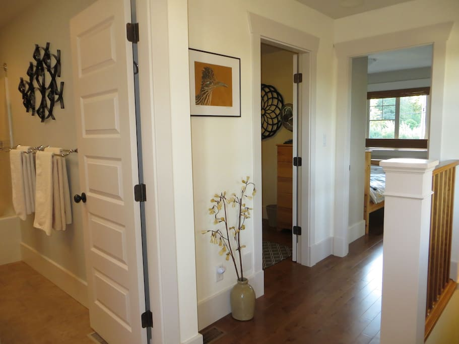 Looking into the shared bathroom, Small Guest Room & our room at the end