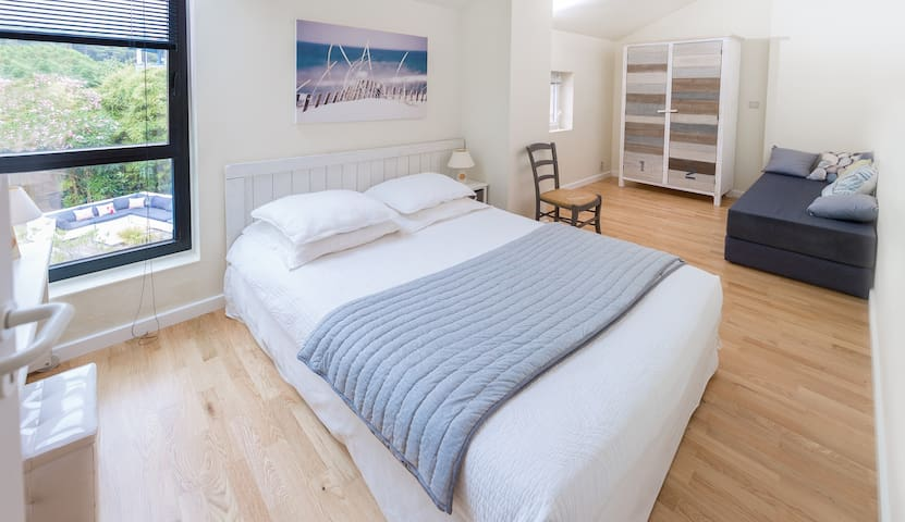 A double bed and a sofa (2 singles or a double).. Views over the pool and garden