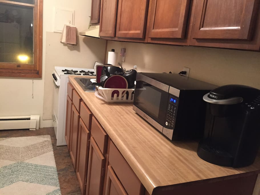 Full kitchen with oven/stove, refrigerator, microwave, and Keurig