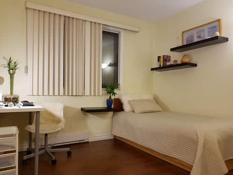 Cozy and bright bedroom next to Fairview mall