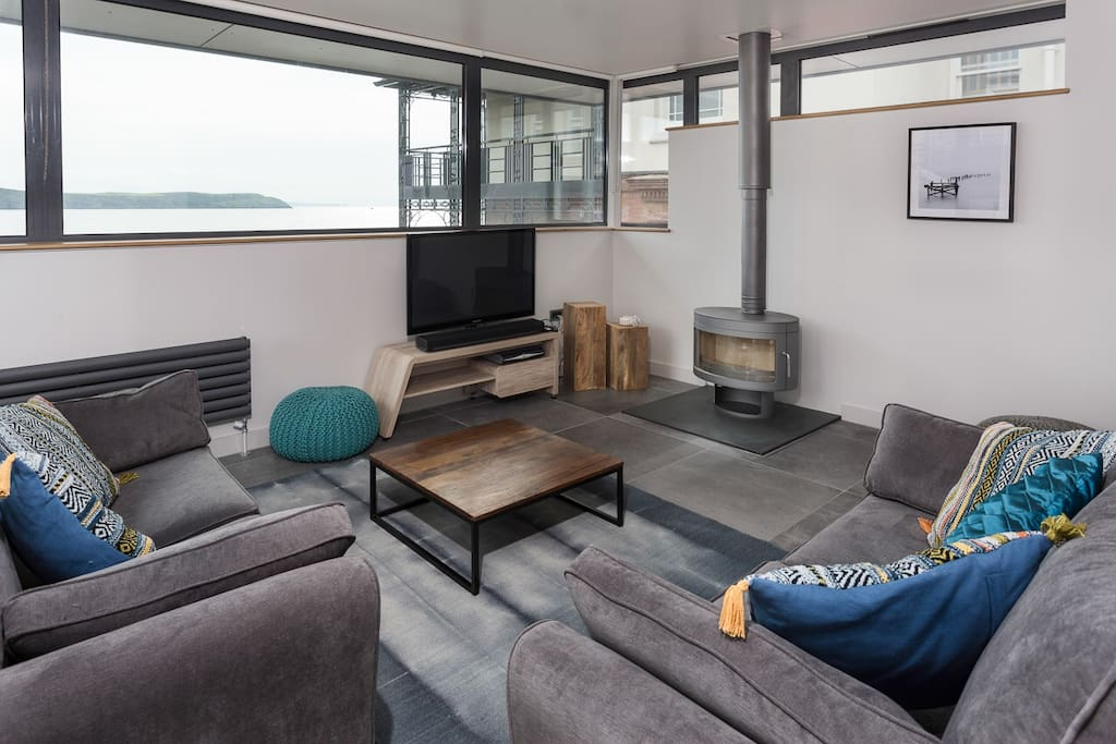 Views to die for, rain or shine from the open plan living area on the top floor of The Beach Hut.