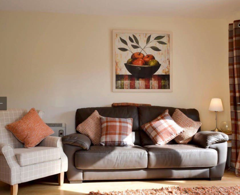 Warm modern Living Room area with stunning views of Ben Nevis.