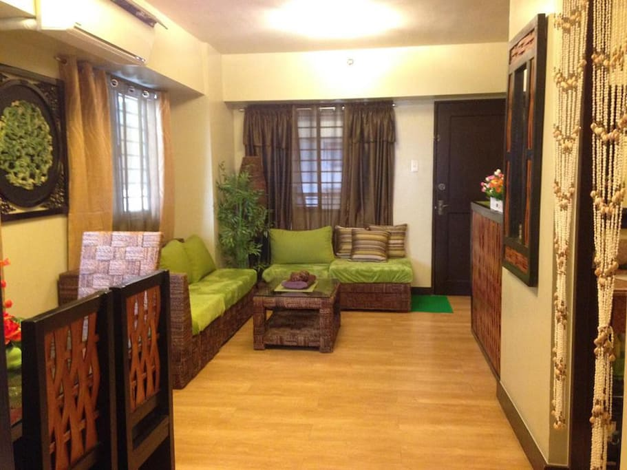 FULLY AIR-CONDITIONED & Furnished with private HOME WIFI, private big balcony OVERLOOKING AMENITIES  and CITY well ventilated and illuminated (3 big windows in d Living Room) No unit attached at d right side, only SKY Patio/Garden w/BEAUTIFUL HUGE BALCONY 5 mins fr. THE FORT. (Taken during rainy season nights)