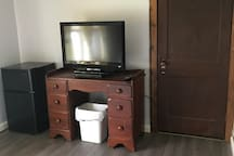 T.V. with dish network and closet