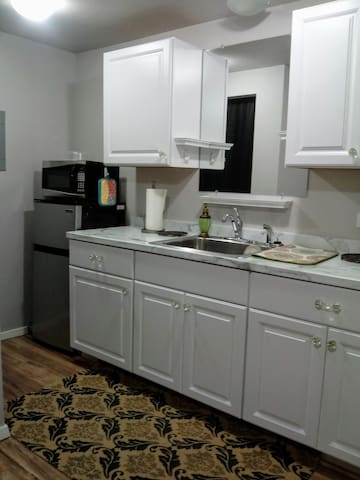 Kitchenette includes fridge, microwave, toaster oven, coffee maker, fry skillet and crockpot.