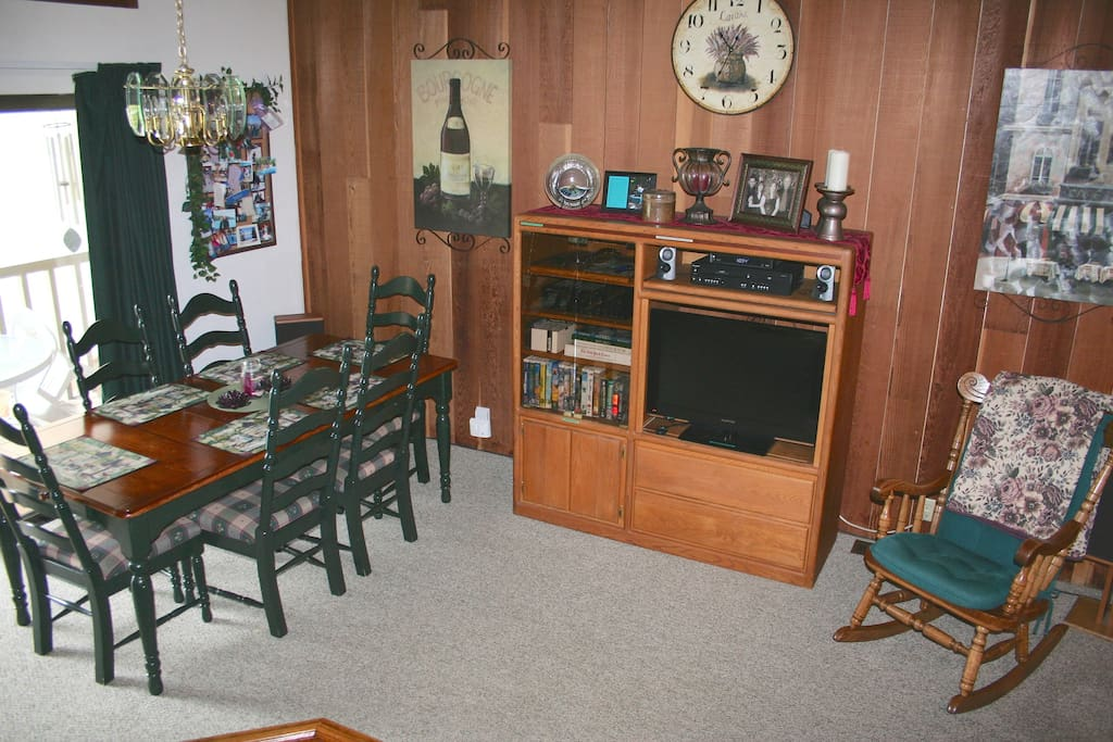 Dining table (seats 6) and entertainment center (TV, DVD/VHS, stereo w/ AUX in)