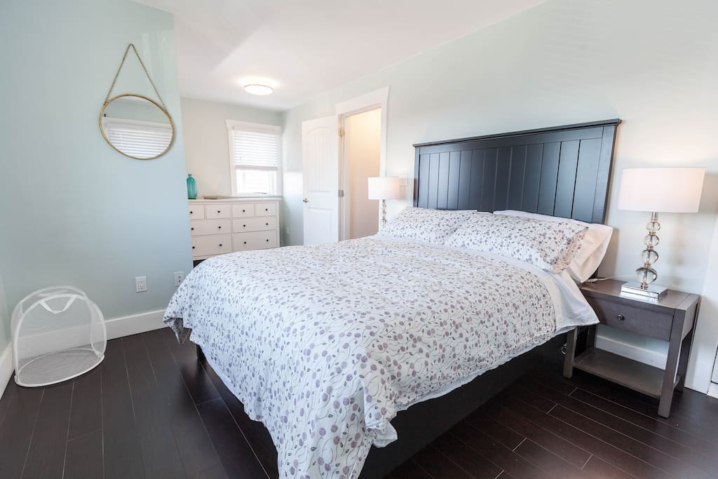 Master bedroom features brand new furniture and decor.