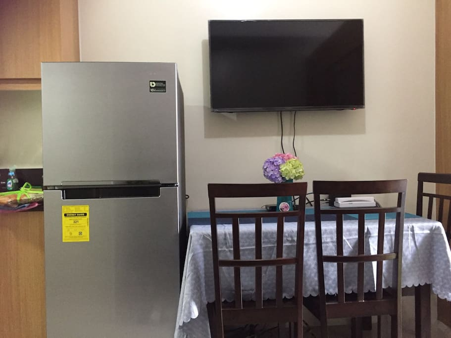 Refrigirator, Dining Table and Television