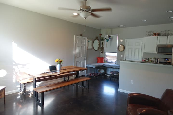 concrete floors. perfect kitchen/workspace. custom built lounge couch/ doggie kennel in corner.