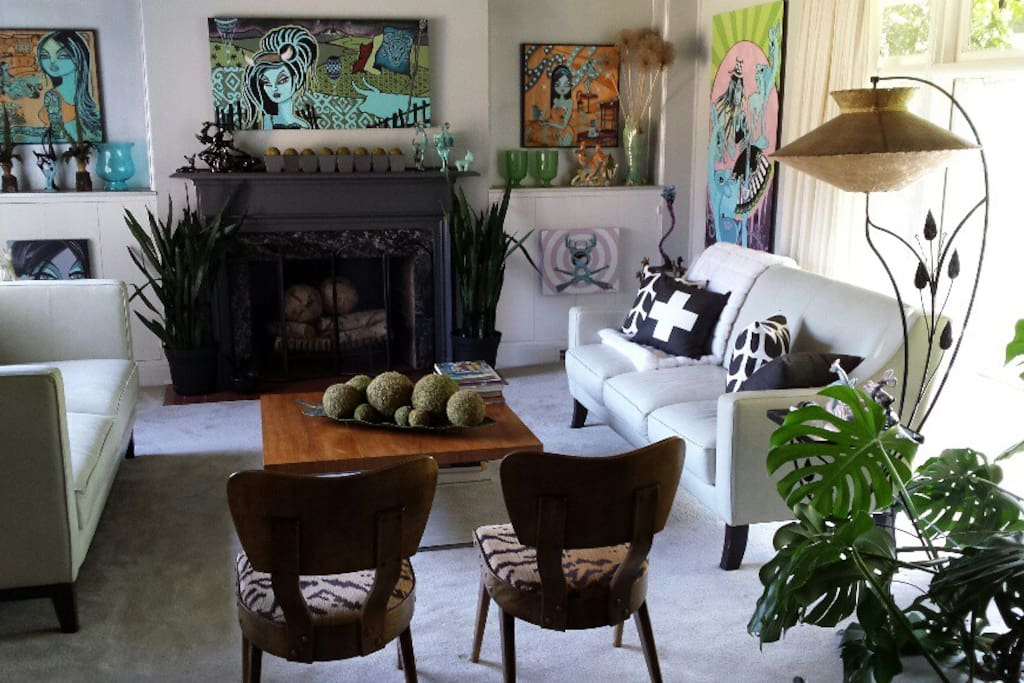Bev Hogue's Beluxe art fills the walls of the living room