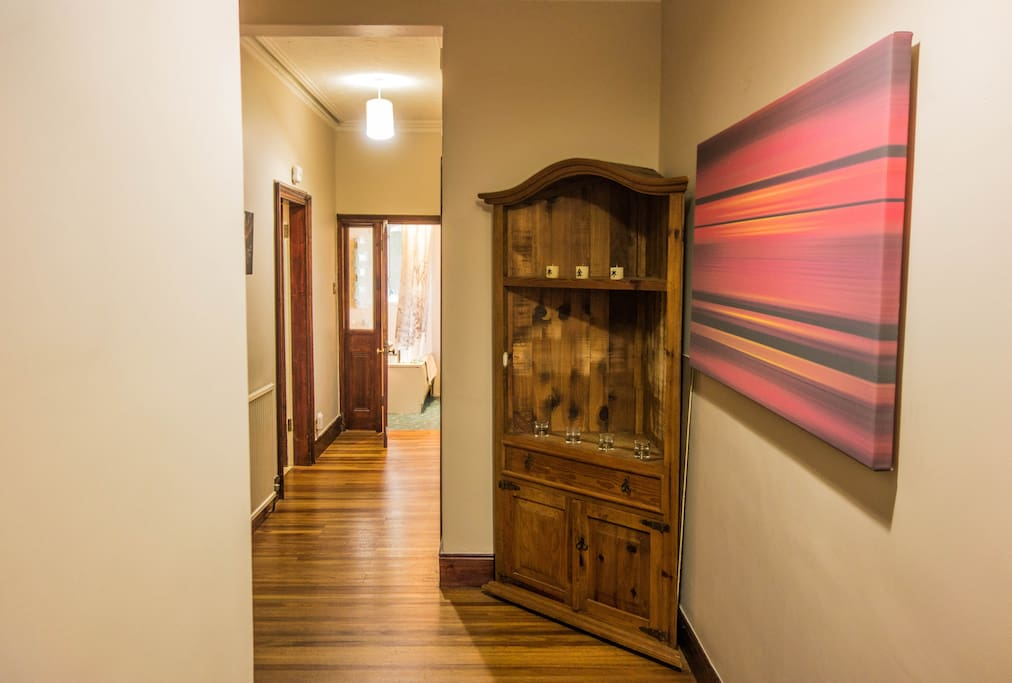 The hallway widens giving a spacious feeling to the property