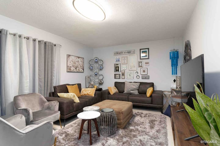 """Sofa, loveseat, chairs and lot of multifunction stools and tables, 65"""" tv, Bluetooth speaker,"""