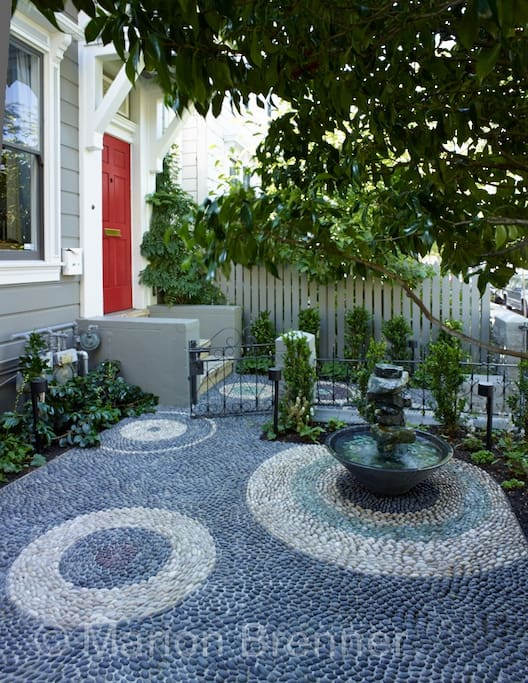 Front Yard (An Italian craftsman came to teach & oversee the installation of this gorgeous risseu)